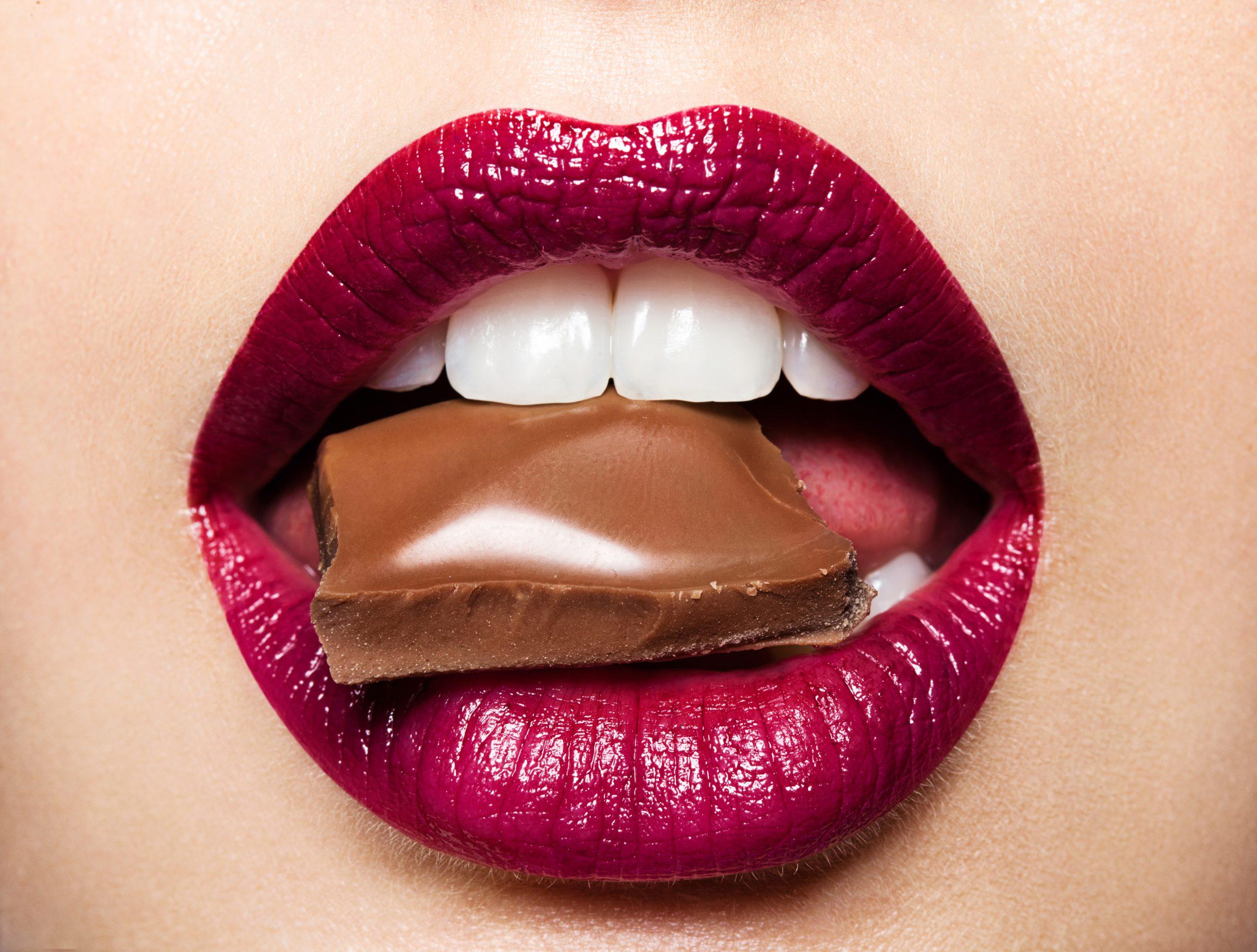 Beautiful female lips with chocolate